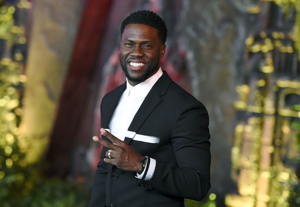 FILE - In this Dec. 11, 2017 file photo, Kevin Hart arrives at the Los Angeles premiere of 'Jumanji: Welcome to the Jungle ' in Los Angeles. Hart will host the 2019 Academy Awards, fulfilling a lifelong dream for the actor-comedian. Hart announced Tuesday, Dec. 4, 2018, his selection in an Instagram statement and the Academy of Motion Picture Arts and Sciences followed up with a tweet that welcomed him 'to the family. ' (Photo by Jordan Strauss/Invision/AP, File)