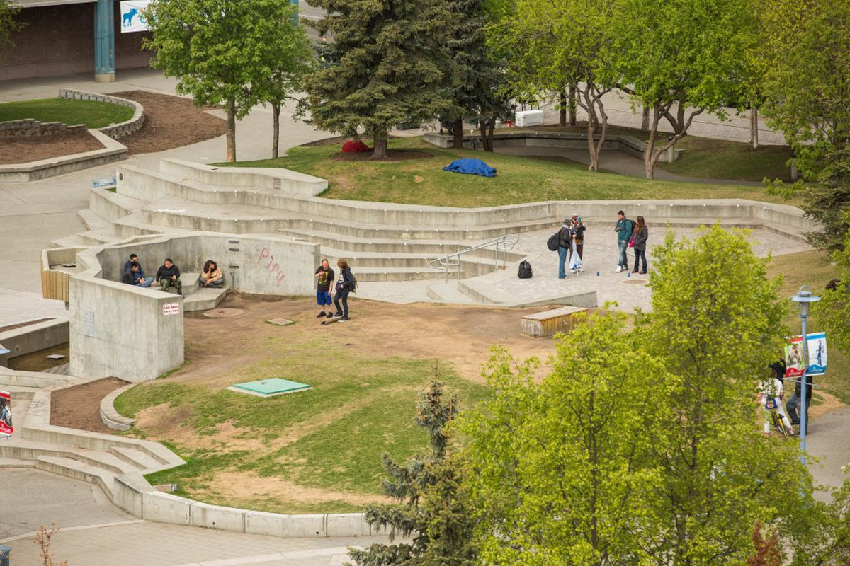 People hanging out and sleeping in Town Square Park midday on May 11, 2016. (Loren Holmes / Alaska Dispatch News)