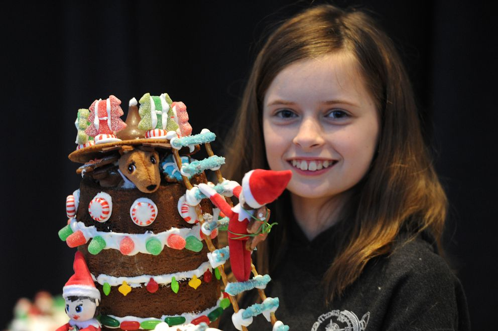 Caelynn Welch, 11, won the youth competition with her entry 'Operation: Steal Santa's Cookies ' at the Gingerbread Showcase, a gingerbread house competition and fundraiser for Habitat for Humanity - Anchorage, during the Christmas Arts & Crafts Emporium at the Dena'ina Center on Sunday, Nov. 24, 2019. (Bill Roth / ADN)