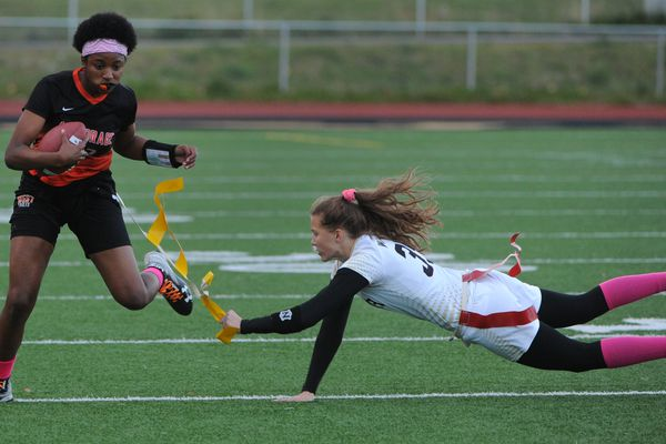 West High quarterback Ah'Kayzee Galloway-Davis is stopped by South High defender Shelby Ottum during the Eagles' 20-12 victory at South High on Thursday, Oct. 11, 2018. (Bill Roth / ADN)