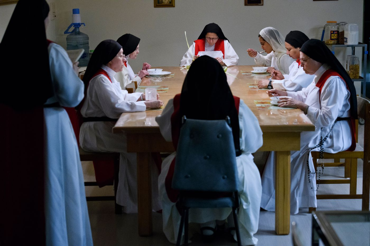 The Sisters of Perpetual Adoration eat breakfast in silence after morning prayers while Sister Miriam de Jesus Cantu, left, stands and reads on March 26, 2018. (Marc Lester / ADN)