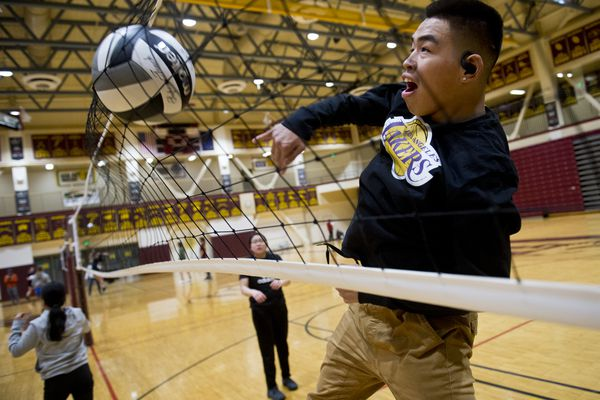 Alakanuk's Jeremiah Hootch practices with his mixed six volleyball team at Dimond High School on December 4, 2019. The Mix Six Volleyball State Championships begins Thursday at Dimond High School. (Marc Lester / Anchorage Daily News)
