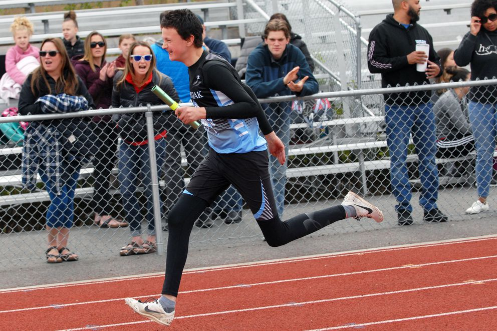 Chugiak's Oz Sparks competes in the partners 4x100 meter relay at the 2019 Cook Inlet Conference Track and Field Championships Saturday, May 18, 2019 at Dimond Alumni Field. (Matt Tunseth / Chugiak-Eagle River Star)
