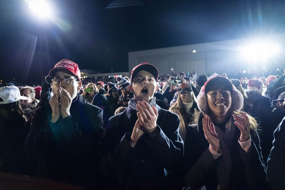 Supporters cheer as President Donald Trump speaks during a rally at Gerald R. Ford International Airport in Grand Rapids, Mich., early Tuesday, Nov. 3, 2020. MUST CREDIT: Washington Post photo by Jabin Botsford