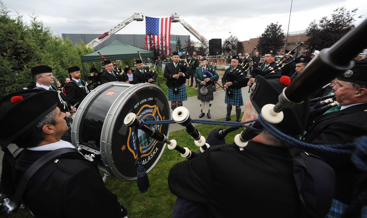 Anchorage Fire Fighters Pipes & Drums Band perform at a ceremony on Sunday, Sept. 11, 2016, at the Alaska Fallen Firefighters Memorial in remembrance of Alaska firefighters and emergency responders who have died in the line of duty. (Bill Roth / Alaska Dispatch News)