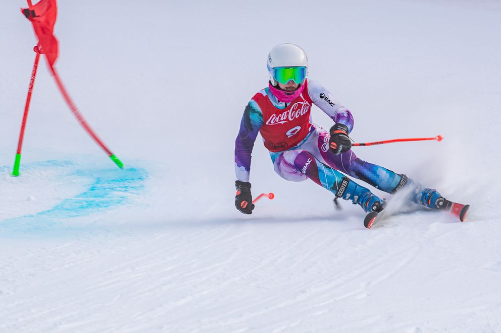 Mary Grace Stahla of the Alyeska Ski Club scrambles after clearing a gate on her way to victory in the second of two Coca-Cola Classic giant slaloms Sunday at Alyeska. (Photo by Bob Eastaugh)