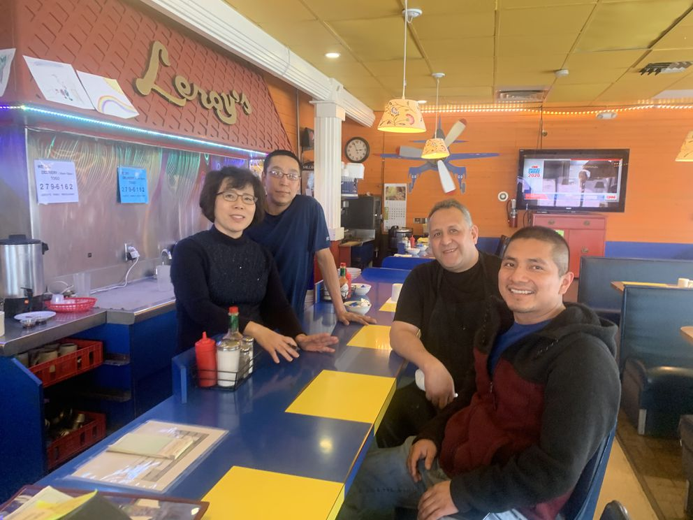 Staff at Leroy's restaurant in Midtown Anchorage pose for a photo on Tuesday, March 17, 2020. Clockwise from left are owner Young Kim and employees William Anaruk, Felipe Robles and Jose Santiago. (Matt Tunseth / ADN)