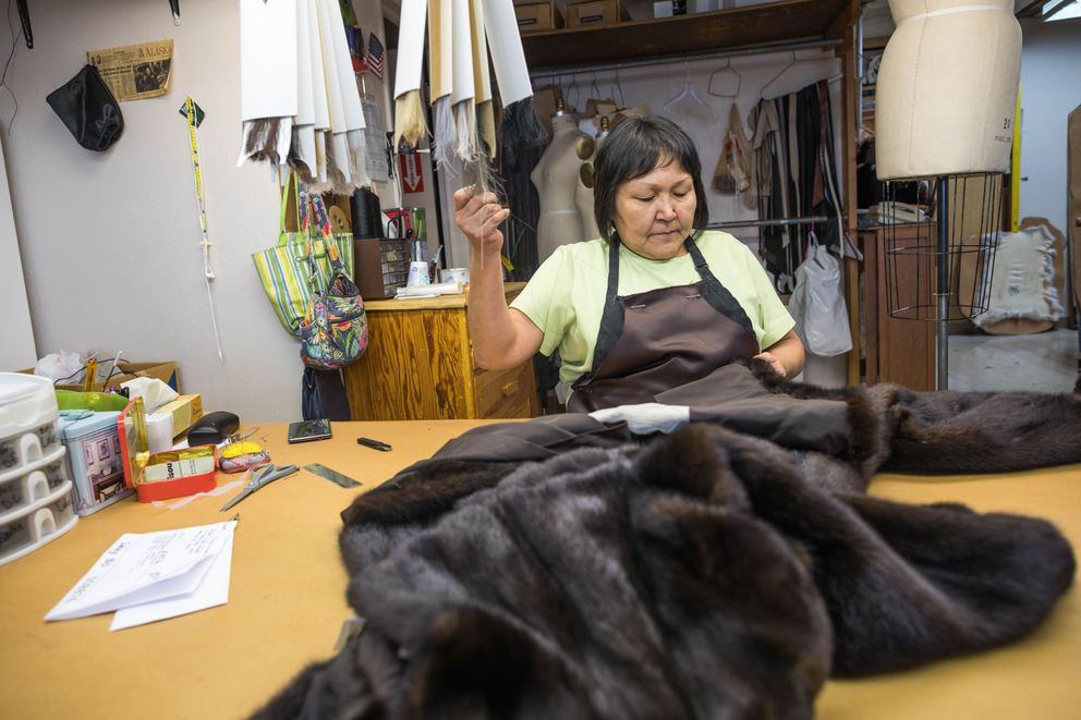 Fur finisher Pauline Tulik works on a mink coat at David Green Master Furrier on Feb. 24. (Loren Holmes / Alaska Dispatch News)