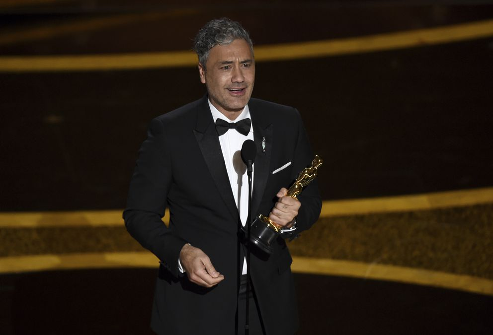 Taika Waititi accepts the award for best adapted screenplay for 'Jojo Rabbit ' at the Oscars on Sunday, Feb. 9, 2020, at the Dolby Theatre in Los Angeles. (AP Photo/Chris Pizzello)