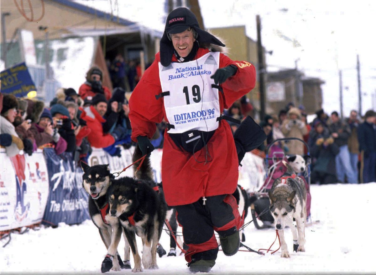 Jeff King leads his dogs down Front Street in Nome during his 1996 Iditarod victory. (Anne Raup / ADN archive)