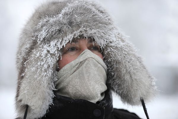 Kate Nixon is bundled up against the cold during an 8-mile walk in Anchorage on Sunday afternoon, Jan. 6, 2019. (Bill Roth / ADN)