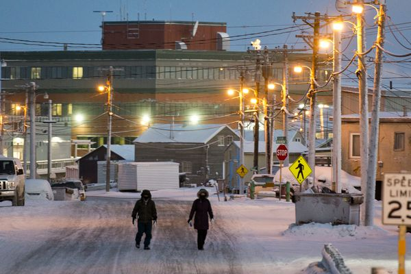 People walk on Stevenson Street in Utqiagvik on Tuesday, December 13, 2016. Voters approved changing the name of the city of Barrow to Utqiagvik in October, a change which went into effect on December 1. In Alaska's northernmost city, however, residents remain divided about whether they name should've changed at all, whether the process was hurried, and whether the Utqiagvik is even the proper Inupiaq place name. (Marc Lester / Alaska Dispatch News)