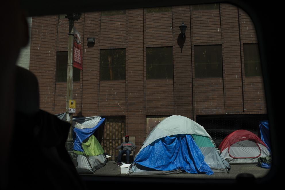 A small encampment is seen in Seattle's Pioneer Square neighborhood. (Photo by Daniel Berman for The Washington Post)