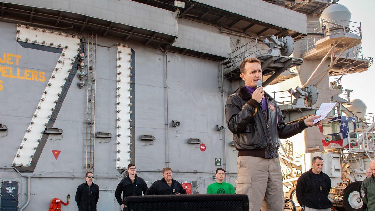 Capt. Brett Crozier, commanding officer of the aircraft carrier USS Theodore Roosevelt (CVN 71), gives remarks during an all-hands call on the ship's flight deck Dec. 15, 2019. MUST CREDIT: U.S. Navy handout photo by Mass Communication Specialist Seaman Alexander Williams