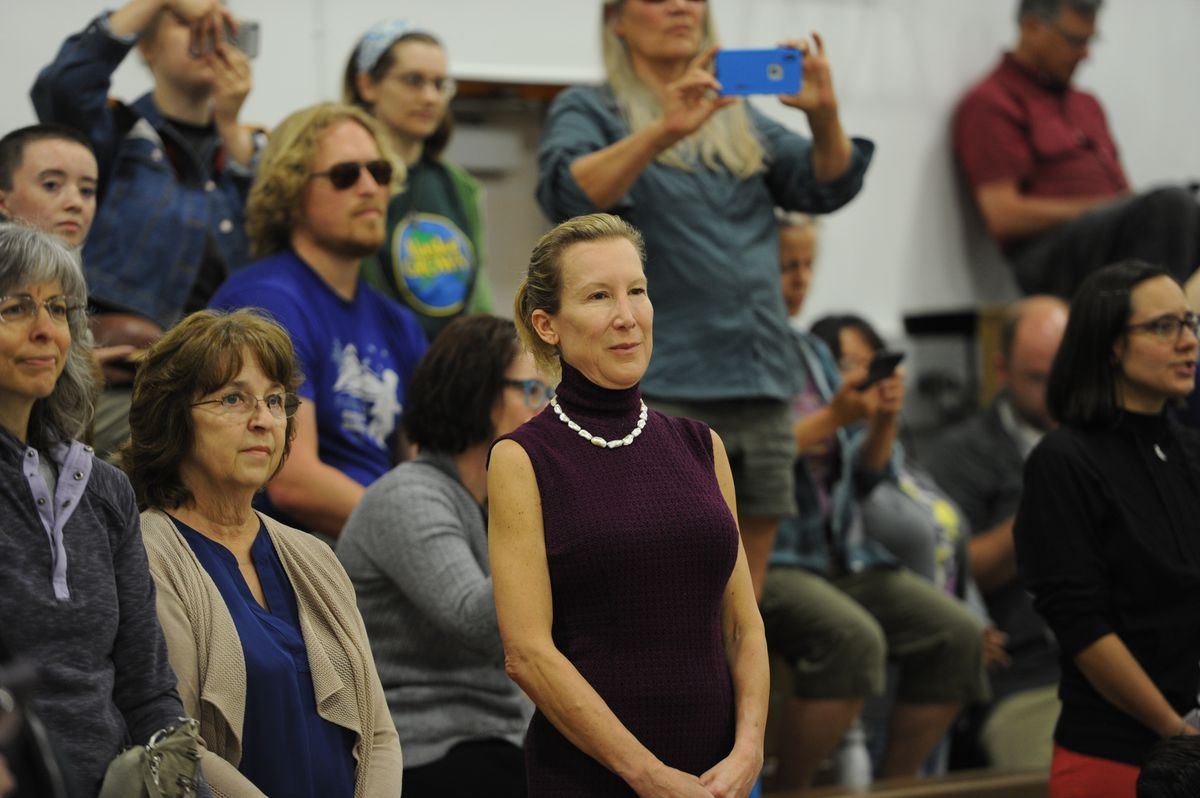 Gov. Mike Dunleavy's Office of Management and Budget Director Donna Arduin, center, watches as protesters hijacked the second day of the legislative special session at Wasilla Middle School on Wednesday, July 10, 2019. (Bill Roth / ADN)