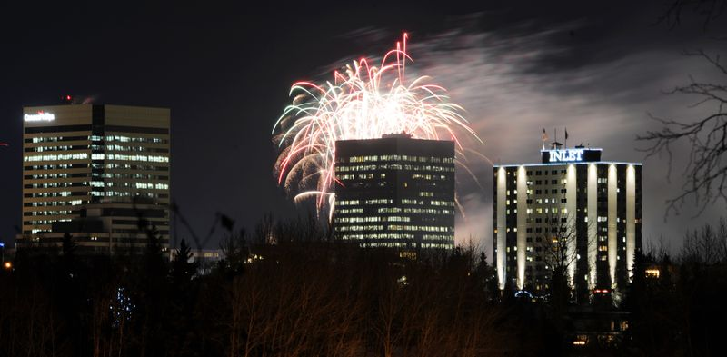 Fireworks display over Anchorage during the new year celebration at Town Square Park on Sunday, Dec. 31, 2017.  (Bill Roth / ADN)