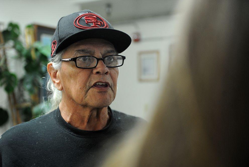 Doug Shepard talks with social worker Tanya Vandenbos at the Anchorage Gospel Rescue Mission. (Bob Hallinen / Alaska Dispatch News)