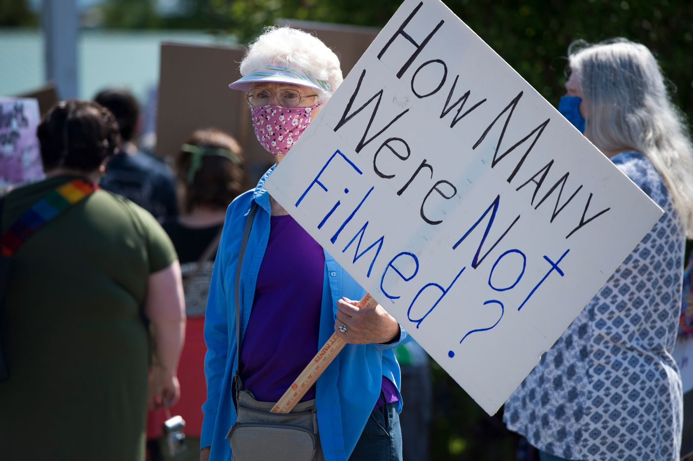 A protester holds a sign at the gathering. A large crowd gathered and marched through Palmer to protest racism and police brutality on Saturday, June 6, 2020. (Marc Lester / ADN)