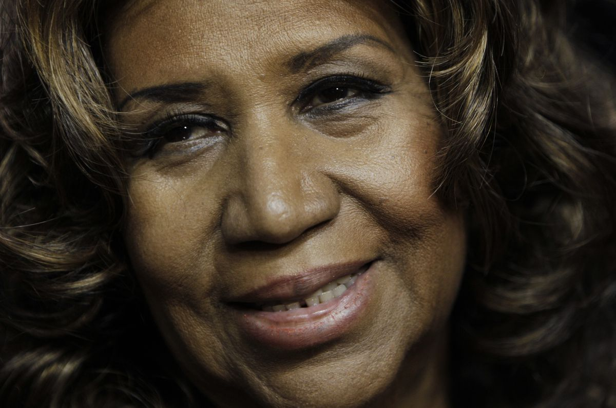 FILE - In this Feb. 11, 2011 file photo, Aretha Franklin smiles after the Detroit Pistons-Miami Heat NBA basketball game in Auburn Hills, Mich. Franklin is seriously ill, according to a person close to the singer. The person, who spoke on the condition of anonymity because the person was not allowed to publicly talk about the topic, told The Associated Press on Monday, Aug. 13, 2018, that Franklin is seriously ill. No more details were provided. (AP Photo/Paul Sancya, File)