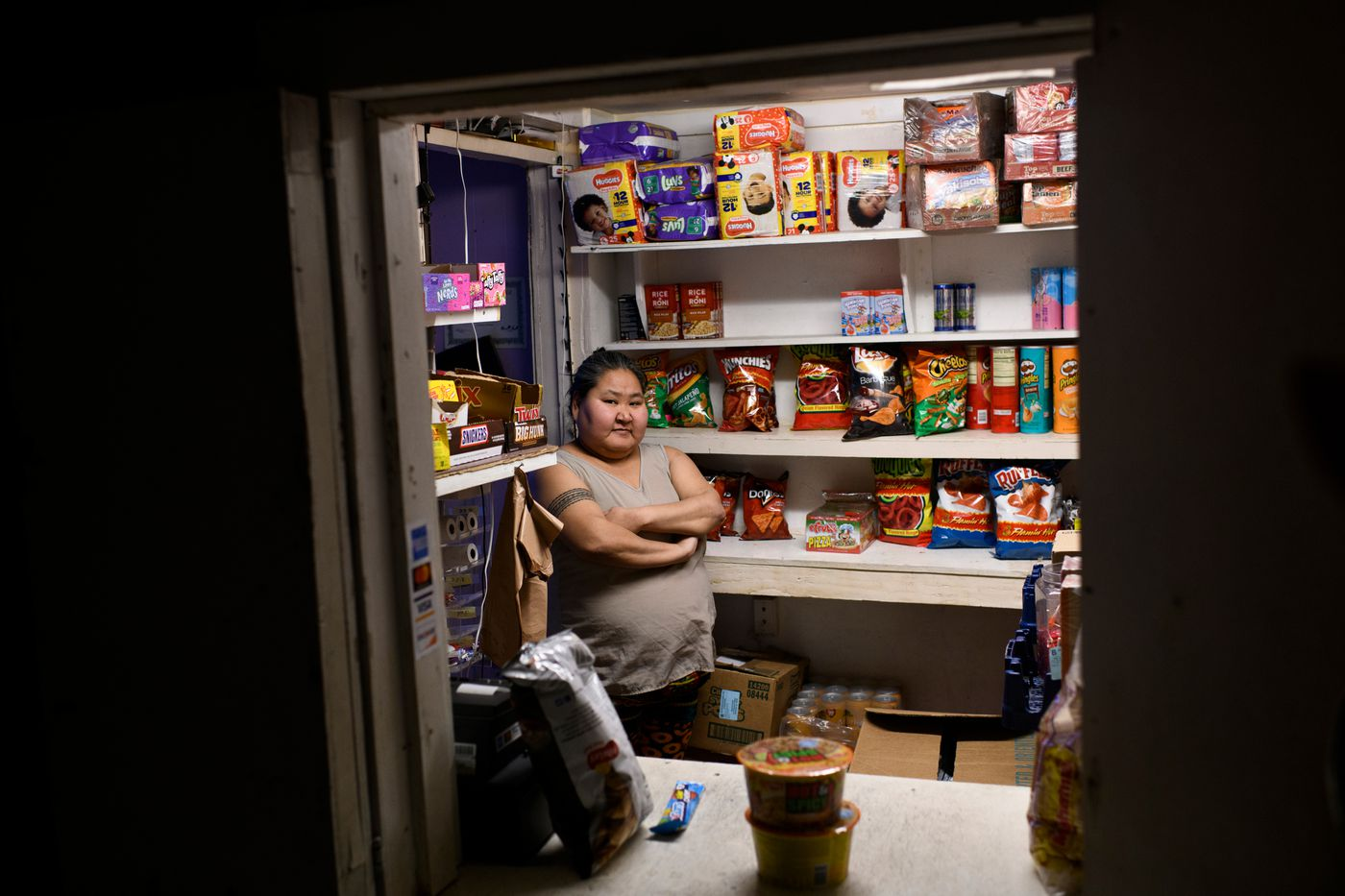 Patricia Coffin runs Mau's Shop, a small store in Noorvik, on December 2, 2018. Coffin said insufficient housing in Noorvik would be a priority for her to address if she were governor of Alaska. (Marc Lester / ADN)