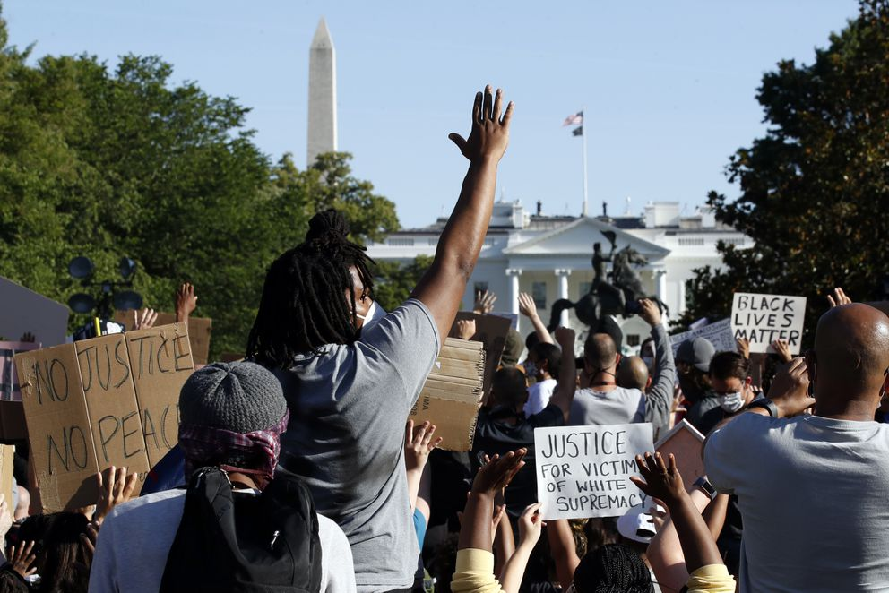 Demonstrators gather in Lafayette Park to protest the death of George Floyd, Monday, June 1, 2020, near the White House in Washington. Floyd died after being restrained by Minneapolis police officers. (AP Photo/Alex Brandon)