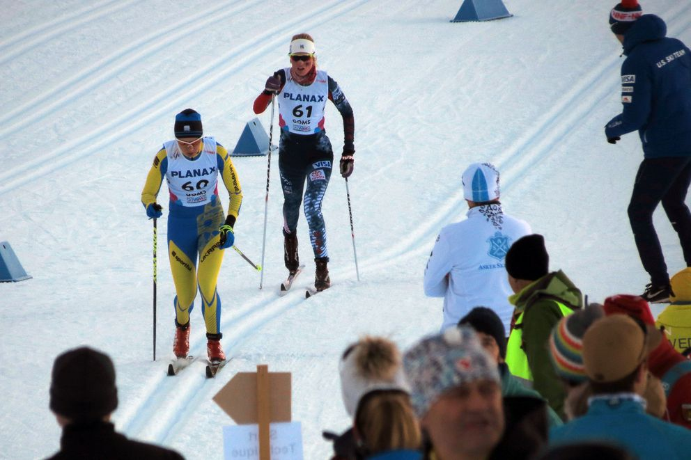 Hailey Swirbul of UAA(61)is about to passYulia Krol of Ukraine as she skis to a silver medal at the World Junior Championships. (Photo by Gunnar Knapp)