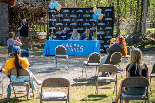 Chugiak High School graduate Adrianna Proffitt sits between her parents in their driveway on Friday, May 15, 2020 before signing a letter of intent to ski for Montana State. (Loren Holmes / ADN)