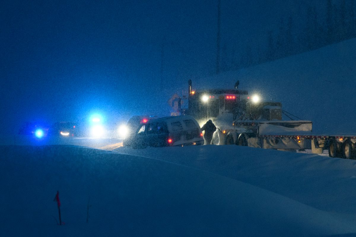 Police investigate an officer-involved shooting on the Elliott Highway, about three miles north of Fox, on Feb. 12, 2019. Fairbanks police say Garrett James Ebenal was shot and killed by police after he pointed a gun at them after a pursuit. (Marc Lester / ADN)