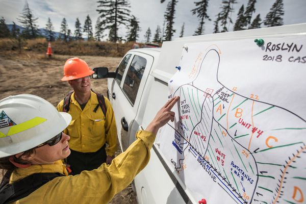 Kara Karboski and Reese Lolley from the Nature Conservancy look over a private landowners acreage that will undergo a prescribed burn above Roslyn. Kara is the coordinator of the prescribed fire council that organized the prescribed fire school training for state, forest service, local and British Columbia fire crews. (Steve Ringman/Times/TNS)