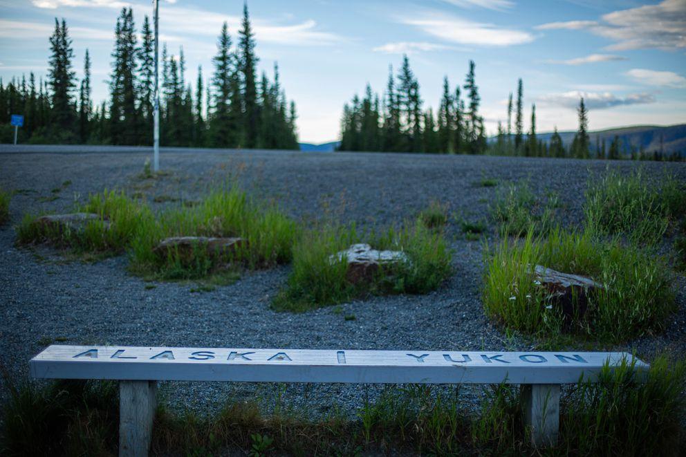 A bench straddles the international border along the Alaska Highway on June 28, 2015. (Loren Holmes / ADN archive)