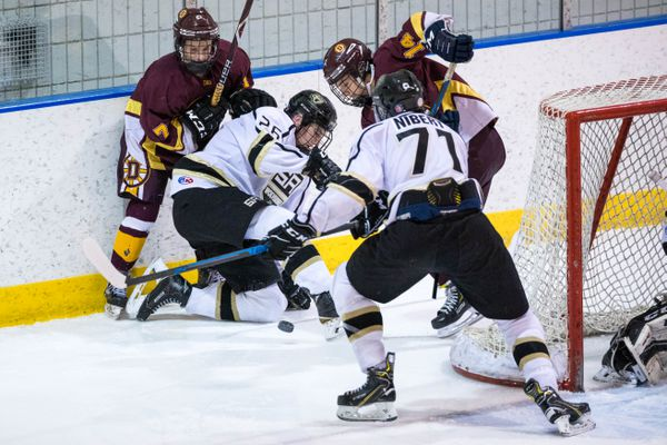 Dimond and South scramble for the puck during the CIC boys hockey championship game Saturday, Feb. 2, 2019 at Ben Boeke. (Loren Holmes / ADN)