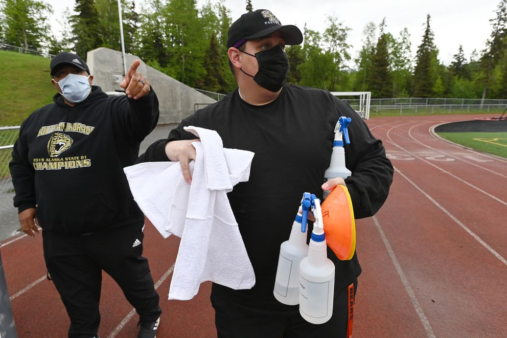 South High Wolverines defensive coordinator and assistant head coach Dana Curtis, left, and offensive line coach Devin Collins prepare for football practice on Monday evening, June 8, 2020. (Bill Roth / ADN)