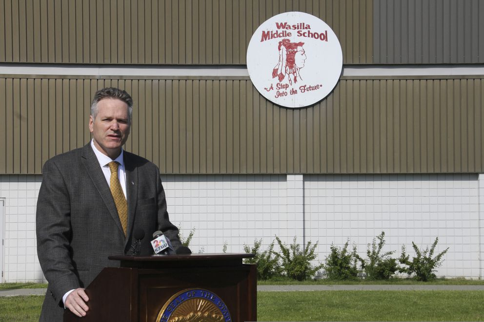This June 14, 2019, photo shows Alaska Gov. Mike Dunleavy speaking at a news conference at Wasilla Middle School in Wasilla, Alaska. Dunleavy has called lawmakers into special session in Wasilla beginning July 8, but some lawmakers have expressed concerns over security and logistics with the location more than 500 miles from the state capital of Juneau, Alaska. (AP Photo/Mark Thiessen)