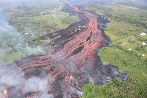 Lava flows downhill, in this image from a helicopter overflight of Kilauea Volcano's lower East Rift zone, during ongoing eruptions of the Kilauea Volcano in Hawaii, U.S., May 19, 2018. USGS/Handout via REUTERS