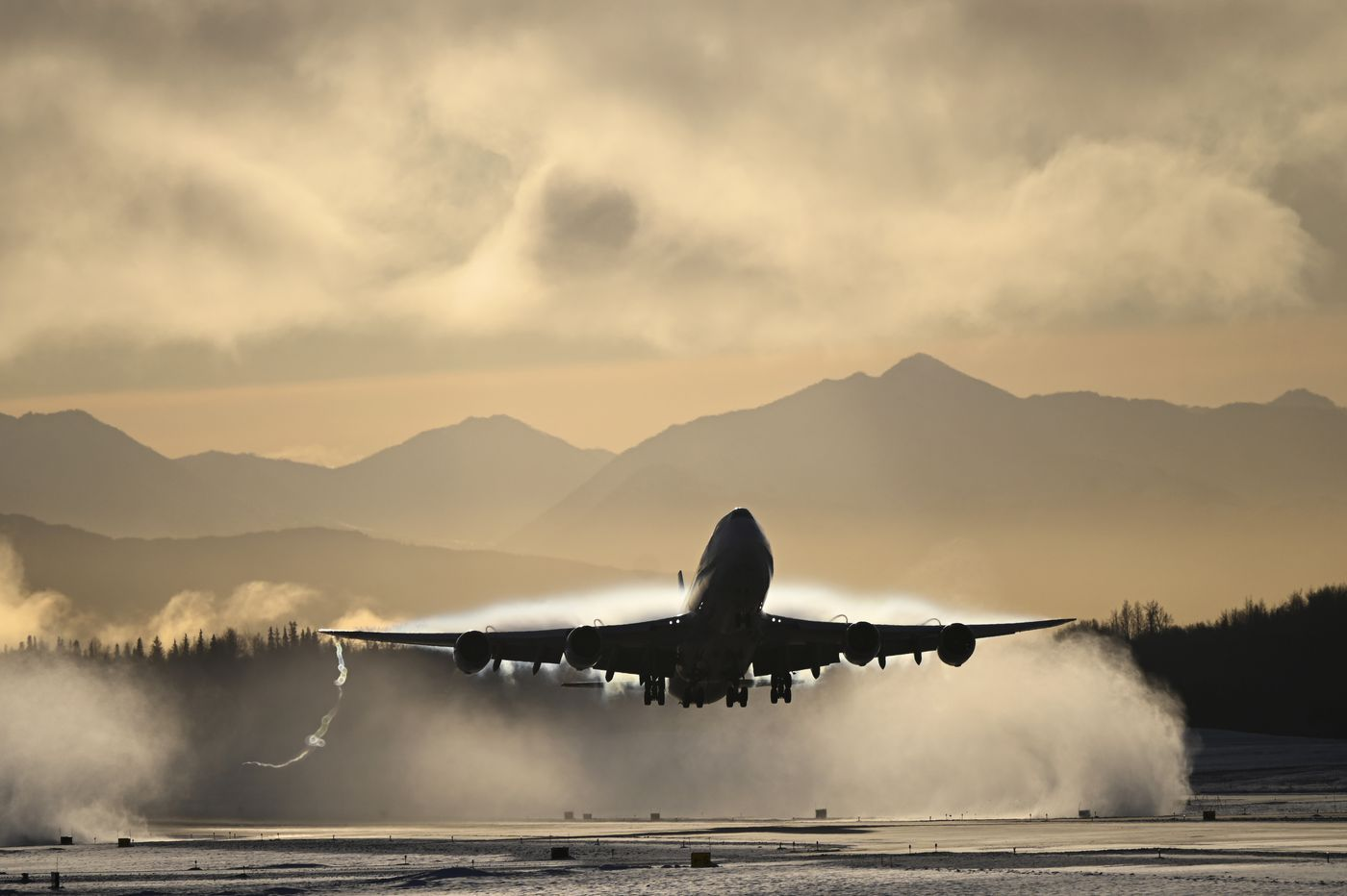 NOVEMBER 22. A vapor cloud forms over the wings as a Cargolux jet lifts off from Ted Stevens Anchorage International Airport. Cargolux is headquartered in Luxembourg. (Marc Lester / ADN)