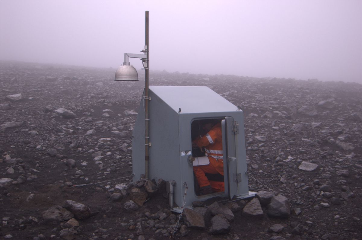 Guy Tytgat in a seismic-station hut near Pavlof Volcano in 2007. (Photo courtesy Alaska Volcano Observatory by Cyrus Read)