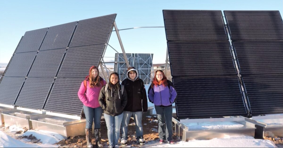 Students pose in front of Buckland's 10.53-kW solar system used to power the village's new water plant. (Photo courtesy Alison Jech / Buckland School via Energy.gov)