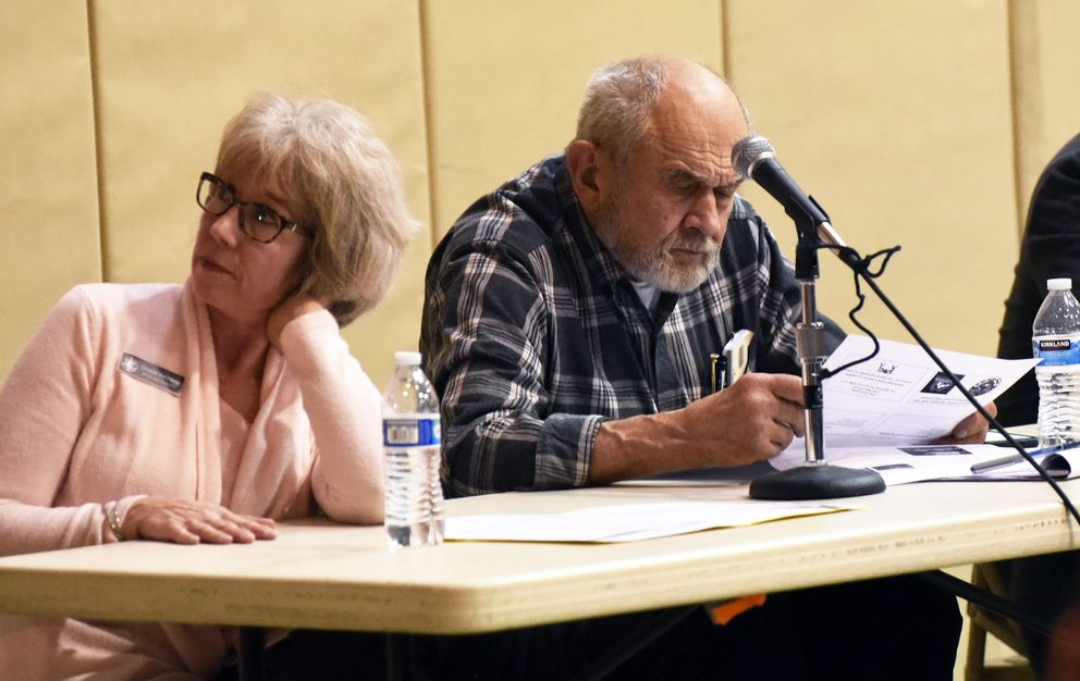 Anchorage Assemblymembers Crystal Kennedy, left, and Fred Dyson during a public forum on the future of Chugiak-Eagle River schools on Monday, Dec. 9, 2019 at Mirror Lake Middle School in Chugiak. (Matt Tunseth / Chugiak-Eagle River Star)