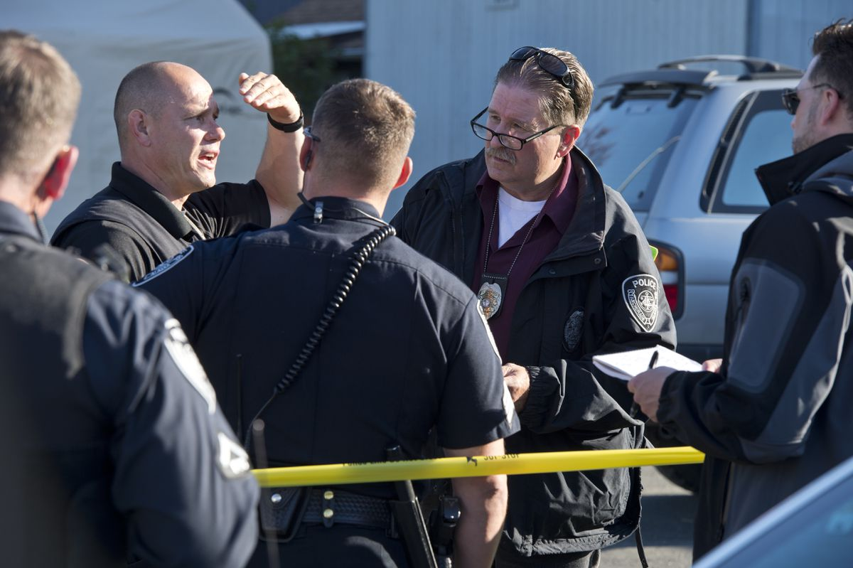 Anchorage police investigate a homicide on North Bliss Street in Anchorage on Friday. (Marc Lester / ADN)