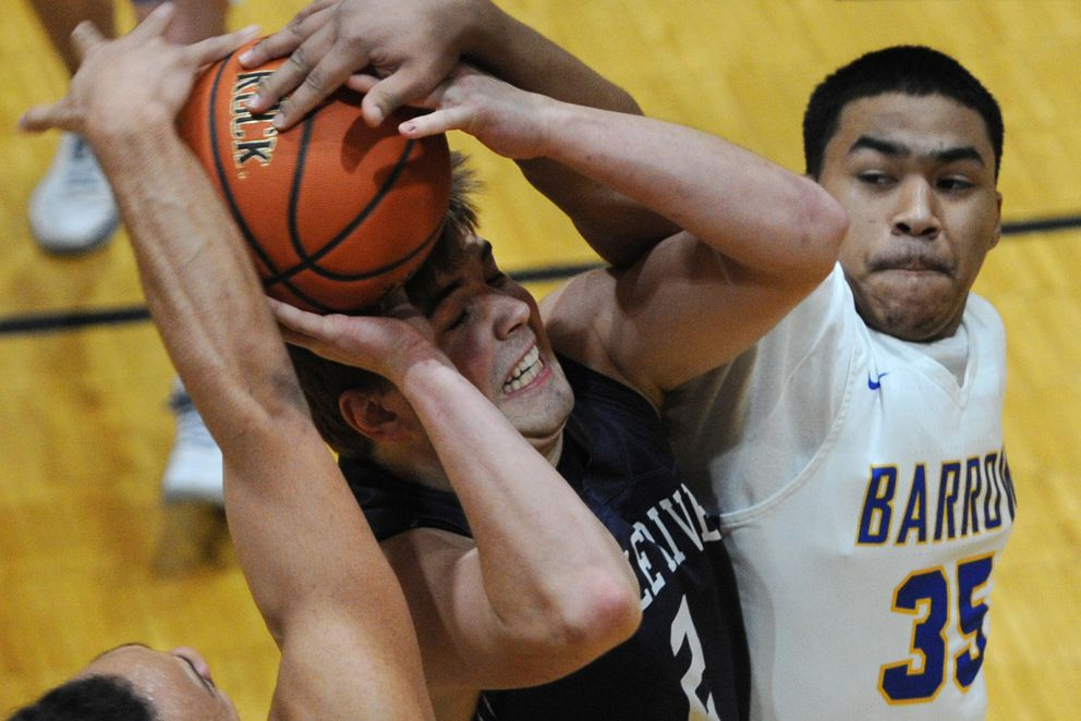 Eagle River senior Ryan Adkins was fouled by Barrow senior Prince Elliott as he drove to the basket during the Wolves' 76-73 OT loss to the Whalers in the opening game of the Alaska Prep Shootout at Dimond High School on Thursday, Jan. 10, 2019. (Bill Roth / ADN)