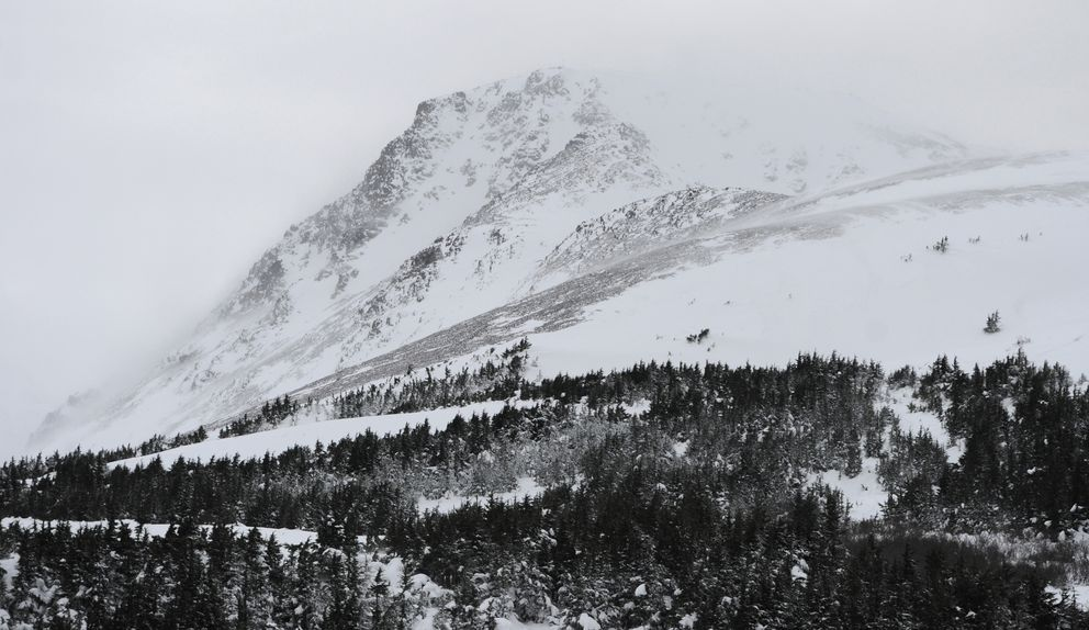 Blowing snow from Southeast winds partially obscure Flattop Mountain in the Chugach State Park during the windstorm Sunday. (Bill Roth / ADN)