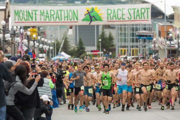 The first wave of men start the 90th Mount Marathon race on Tuesday, July 4, 2017 in Seward. (Loren Holmes / Alaska Dispatch News)
