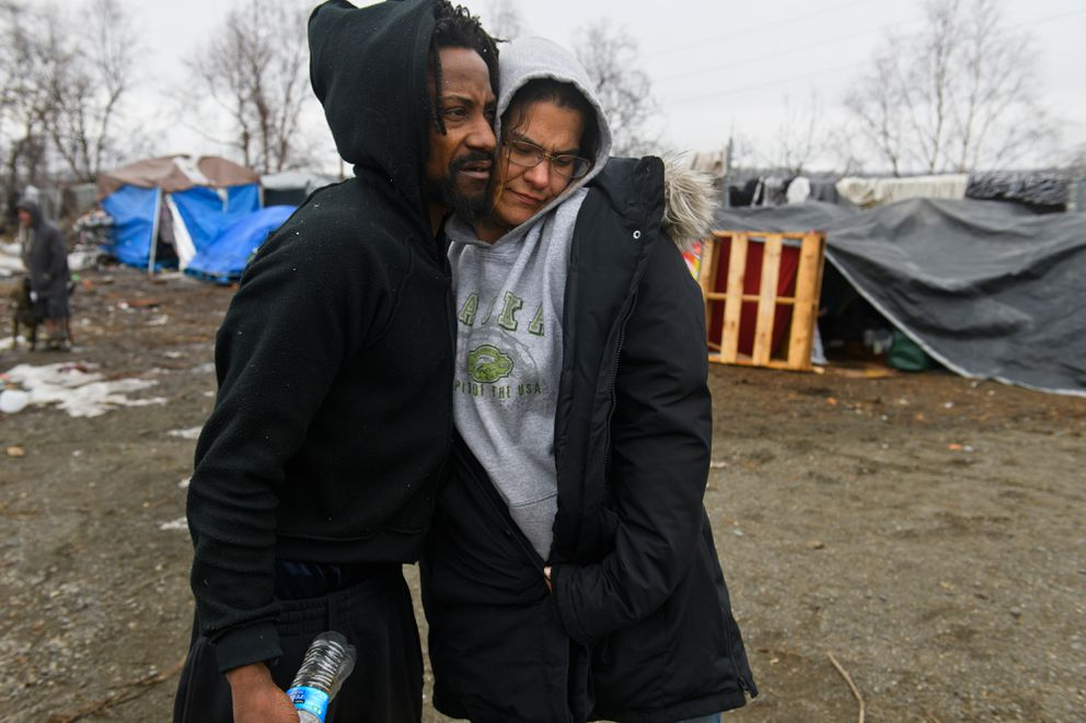 Nathaniel Hicks Jr., left, hugs Samantha Alex at a homeless camp near Third Avenue and Ingra Street. (Marc Lester / ADN)