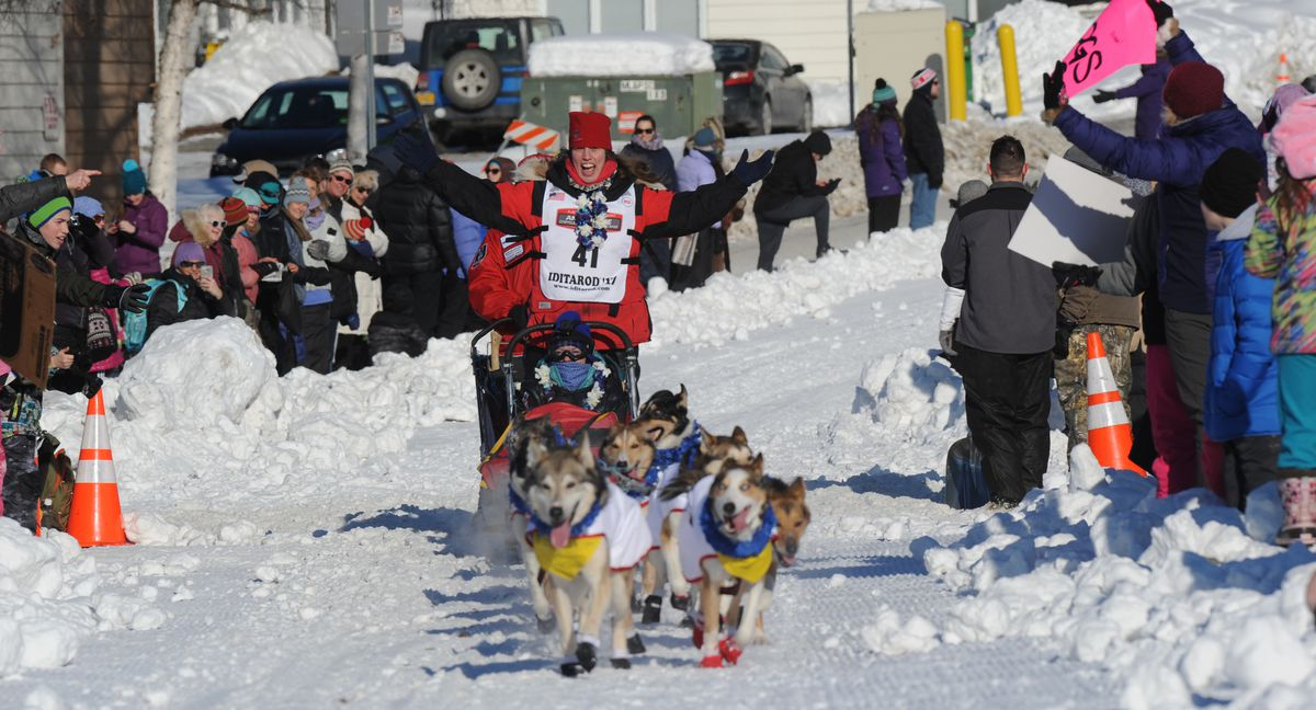 Aliy Zirkle acknowledges cheers as she winds through parties situated along the course at 16th Avenue during the Iditarod Trail Sled Dog Race ceremonial start on Saturday, March 4, 2017, in Anchorage. (Erik Hill / ADN archive)