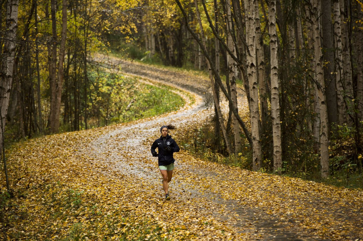 Rosie Frankowski runs along the Tony Knowles Coastal Trail near Earthquake Park on Monday, September 28, 2020. Frankowski, from Minneapolis, is a member of the Alaska Pacific University's elite cross country ski team and a member of the 2018 U.S. Olympic team in Pyeongchang. (Marc Lester / ADN)
