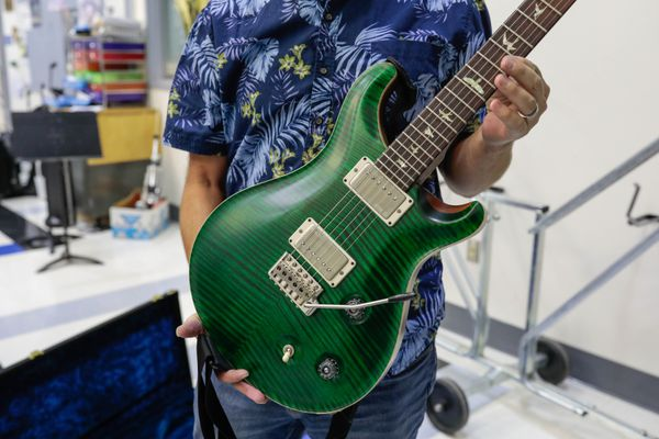A Brazilian rosewood veneer is seen on the neck of a custom Paul Reed Smith 24-fret double-cutaway electric guitar on Wednesday, Sept. 18, 2019 at East High School. The high-end guitar, one of ten, was seized in July 2018 by the U.S. Fish and Wildlife Service on it's way to Hong Kong because it did not have proper documentation under the Convention on International Trade in Endangered Species of Wild Fauna and Flora (CITES) treaty. The guitars are now being used by the Anchorage School District. (Loren Holmes / ADN)