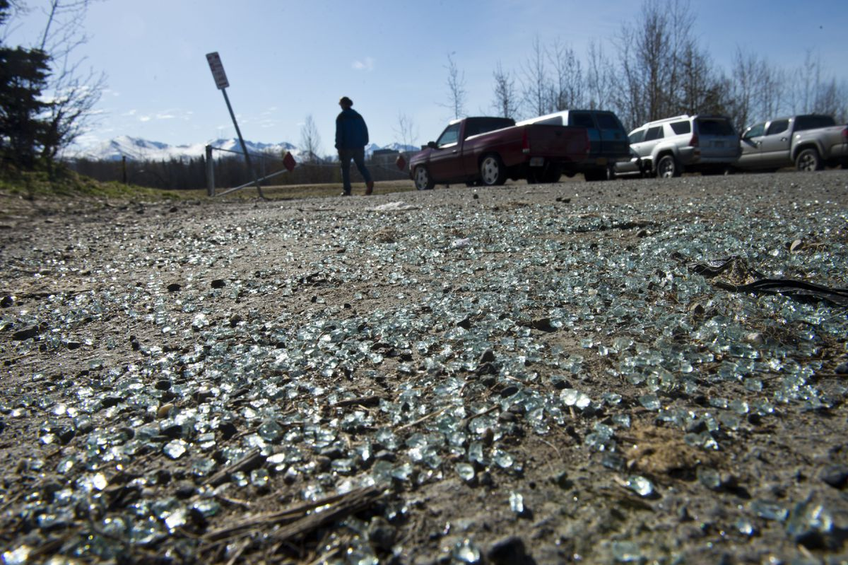 Broken glass on the ground in a parking area at University Lake on May 1, 2019. (Marc Lester / ADN)