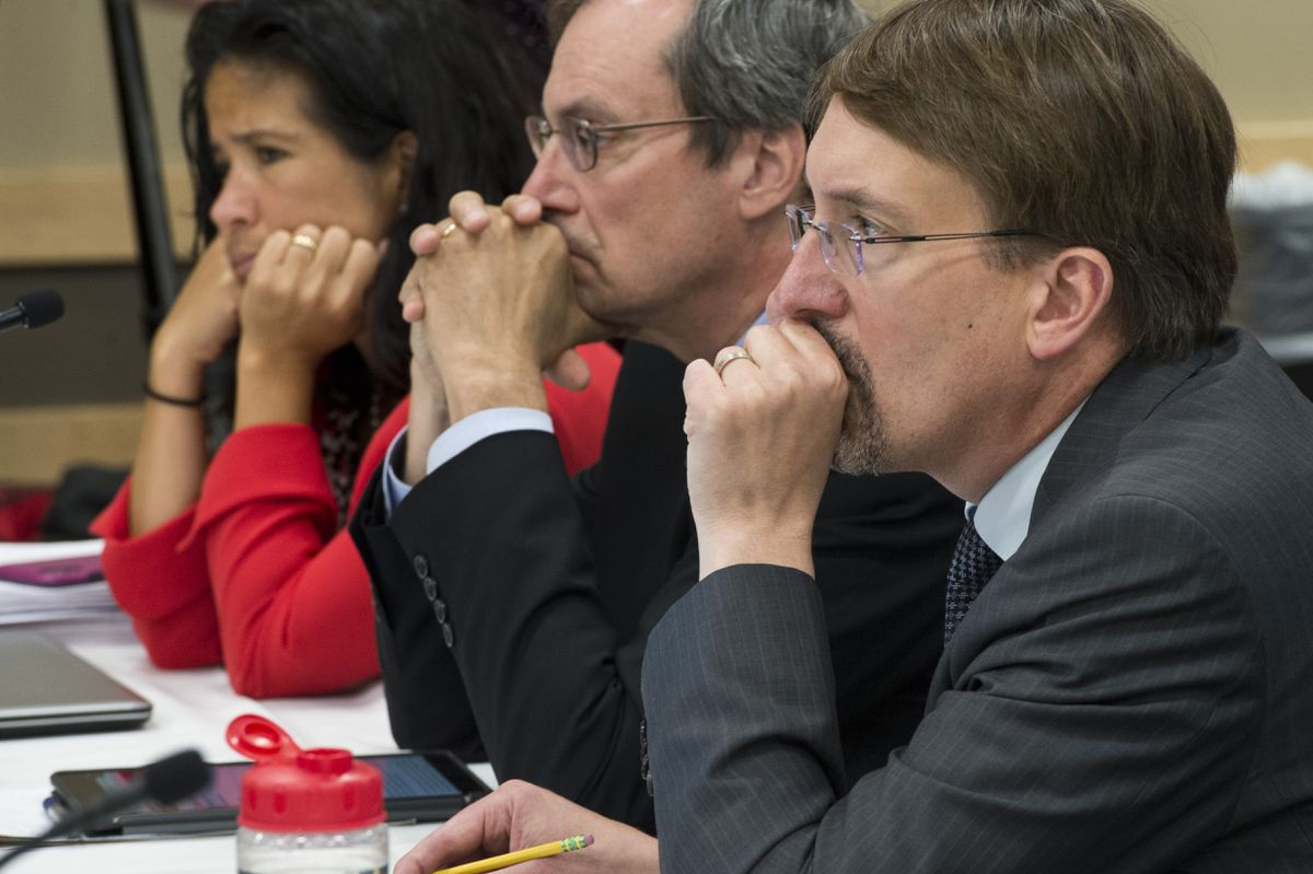 From left, Michelle Rizk, vice president for university relations, Paul Layer, vice president for academics, students and research, and Myron Dosch, chief financial officer, listen to discussion. The University of Alaska Board of Regents voted to declare financial exigency on Monday, July 22, 2019, during a meeting at UAA's Gorsuch Commons. (Marc Lester / ADN)