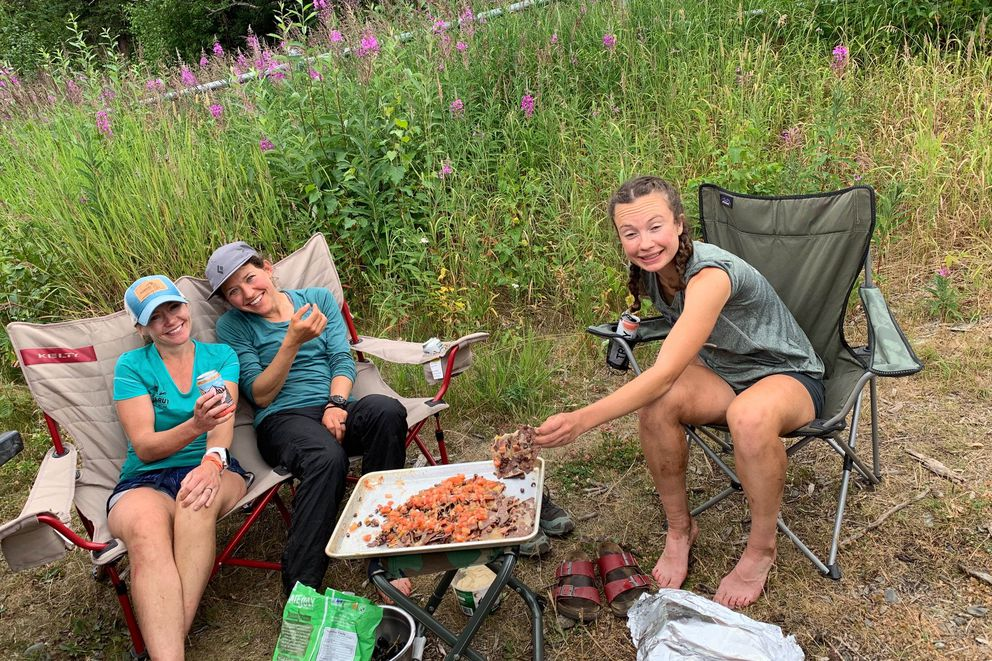 From left, April McAnly, Julianne Dickerson and Abby Jahn eat nachos from the comfort of camp chairs after completing the 12-peak Challenge. (Photo courtesy of Julianne Dickerson)