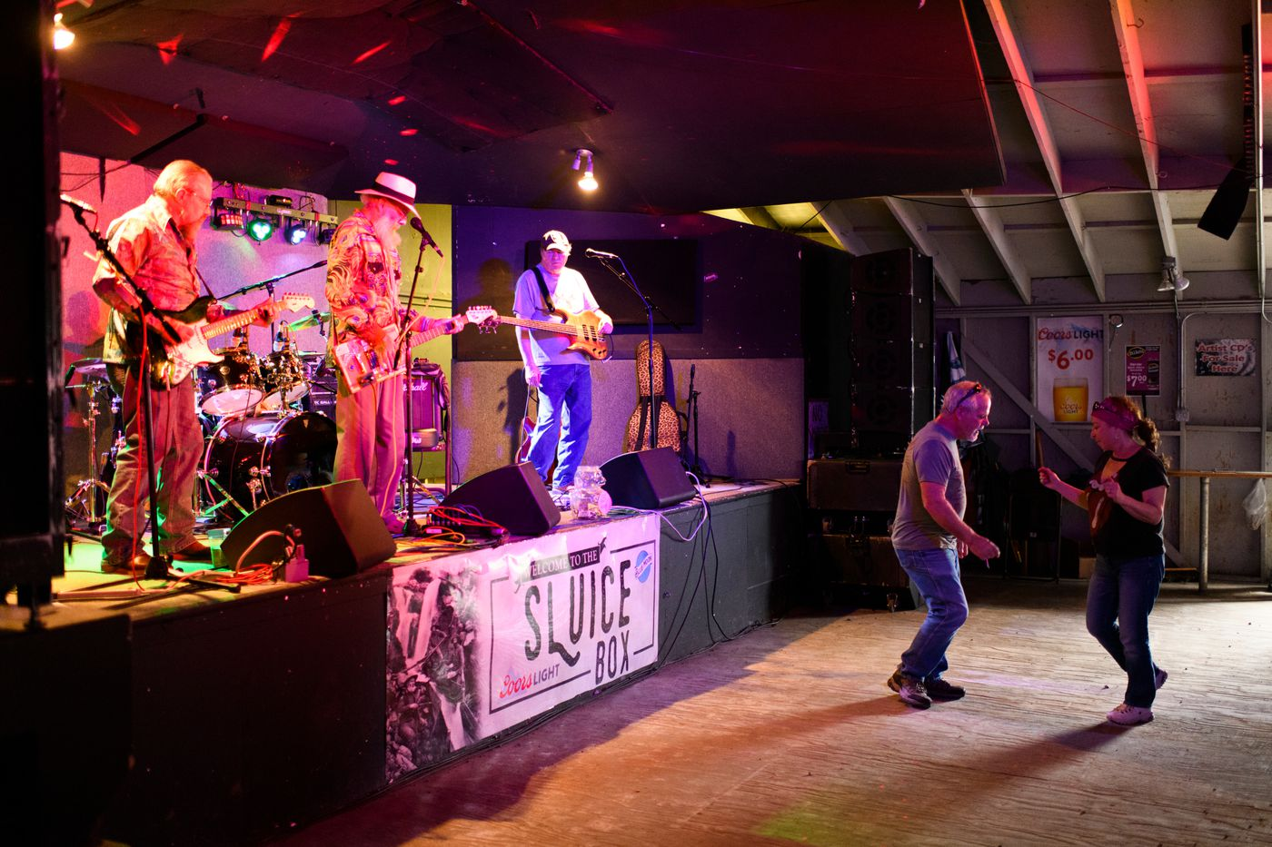 Blues musician Gary Sloan, at center on stage, performs with his band at the Sluice Box. (Marc Lester / ADN)